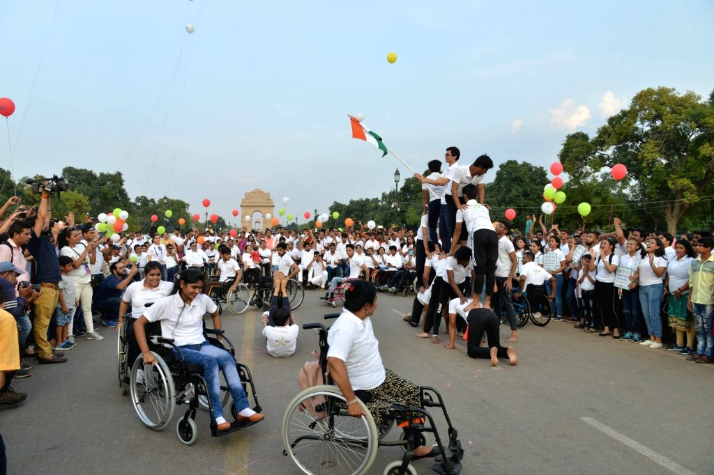 Participants during the 'Wheelchair Rally' organised on the occasion of World Spinal Injury Day at India Gate in New Delhi on Sep 8, 2019.