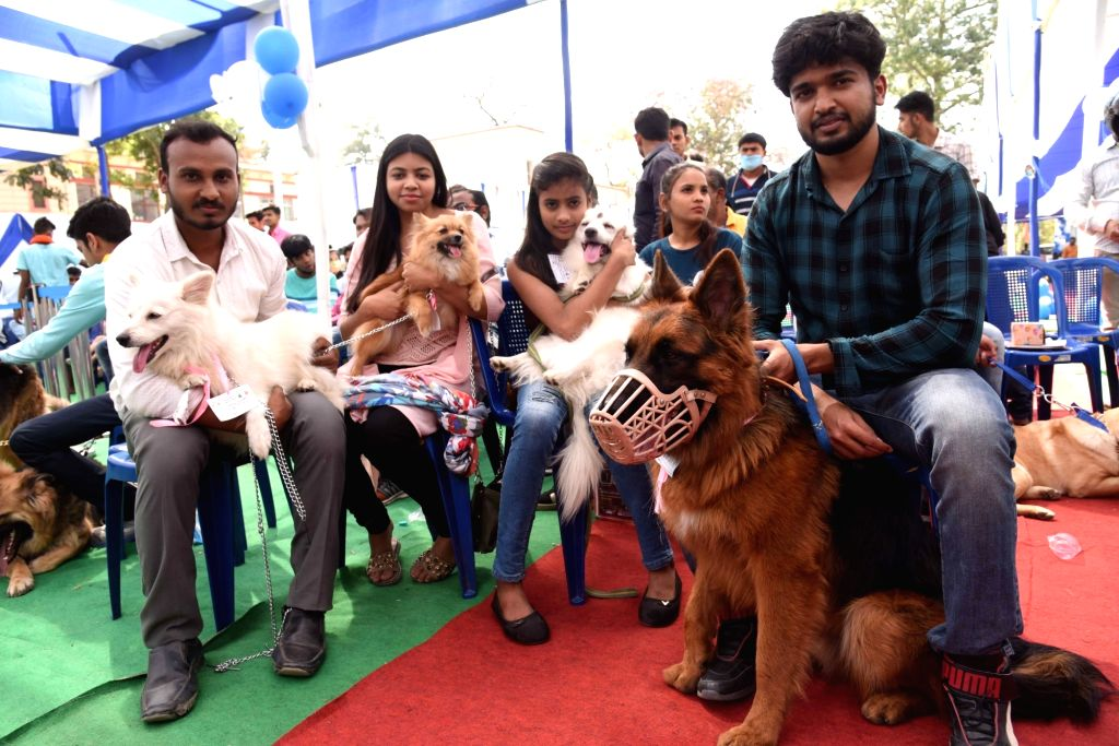 Participants hold their pets during a Dog Show competition at Bihar Veterinary college in Patna on Saturday 06th March, 2021.