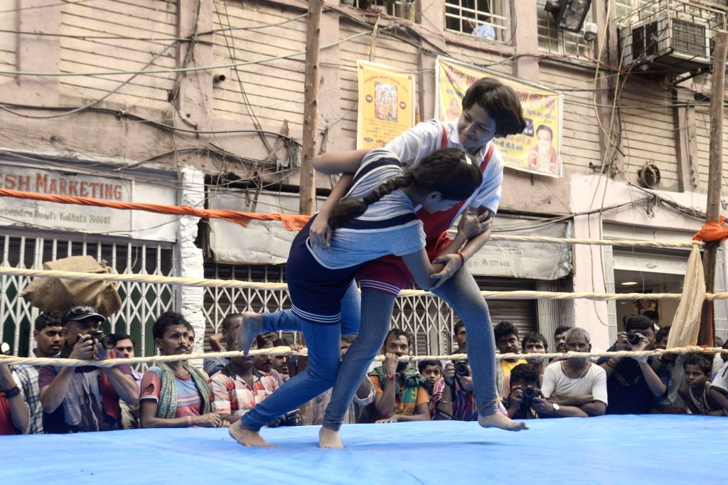 Participants in action during a Wrestling and belt wrestling competition organised on the occasion of Diwali in Kolkata on Nov 5, 2018.