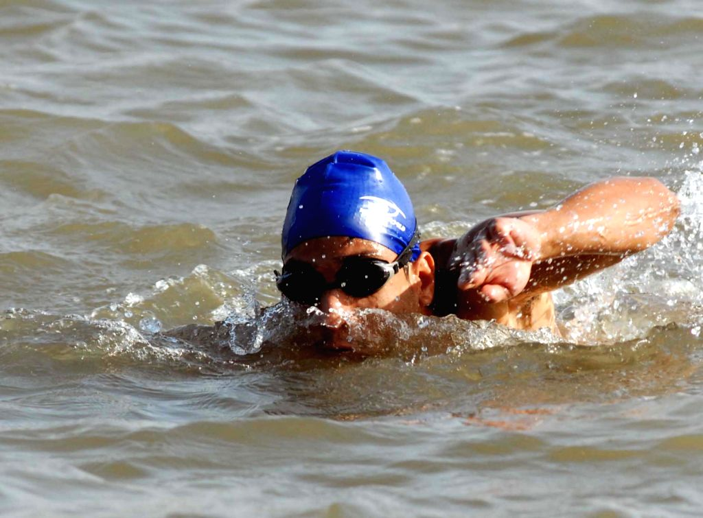 """Participants of Square Off Mumbai Swimmathon 2013 practicing in Arabian Sea near gateway of  India on Feb. 7. For its second edition  on February 10. """"Square Off Mumbai Swimmathon 2013"""" - .."""