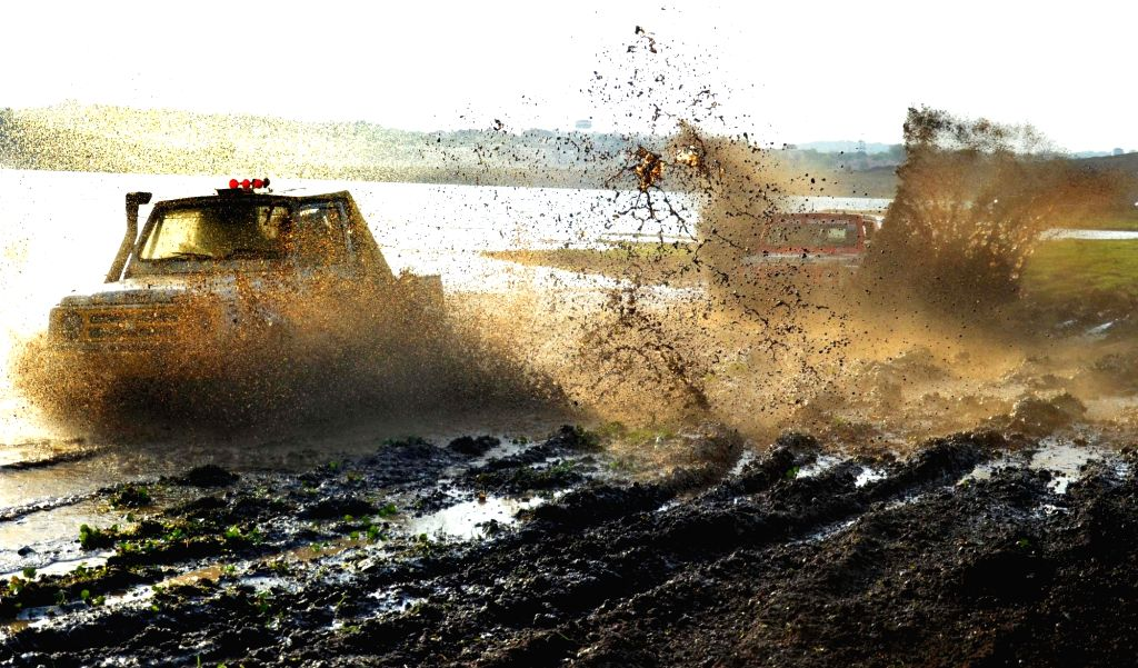Participants practice ahead of Mud Challenge rally at Kaliyasot Dam Adventure Zone in Bhopal on June 17, 2017.