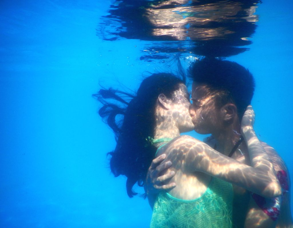Participants take part in an underwater kissing contest in Wuhan, capital of central China's Hubei Province, Aug. 2, 2015. A total of 11 couples took part in the ...