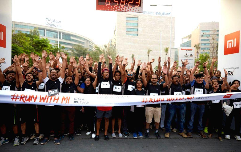Participates during a marathon in Bengaluru, on March 31, 2018.