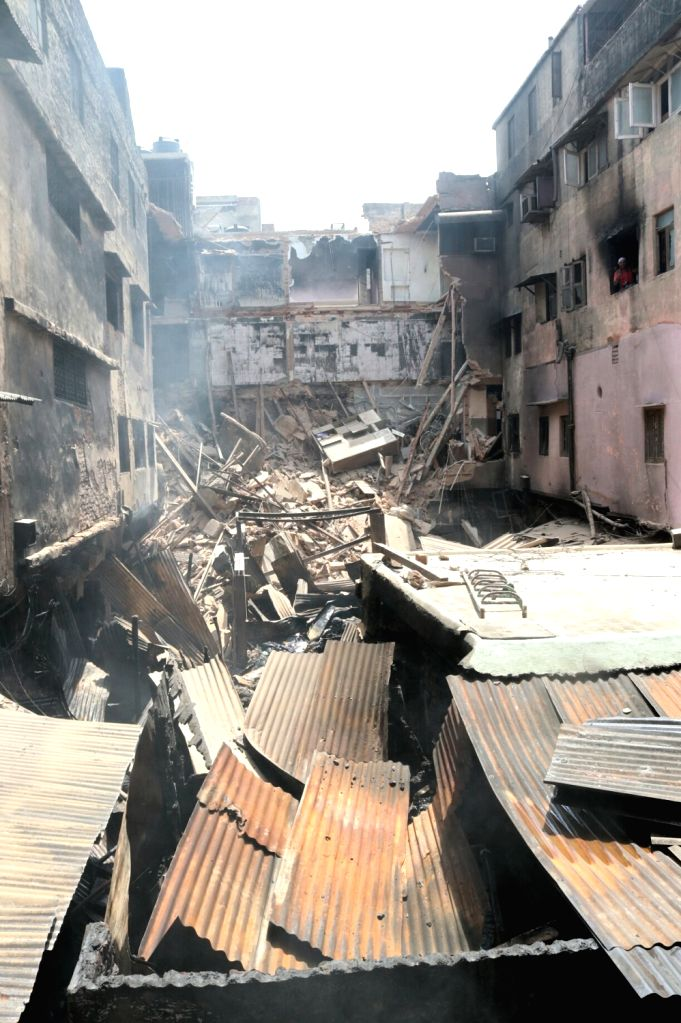 Parts of the building collapsed as a major fire broke out in a cloth shop of the building in Chandni Chowk, Delhi on May 23, 2017.