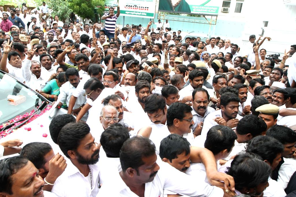 Party workers at the AIADMK headquarters during the merger of the two factions of the party in Chennai on Aug 21, 2017.