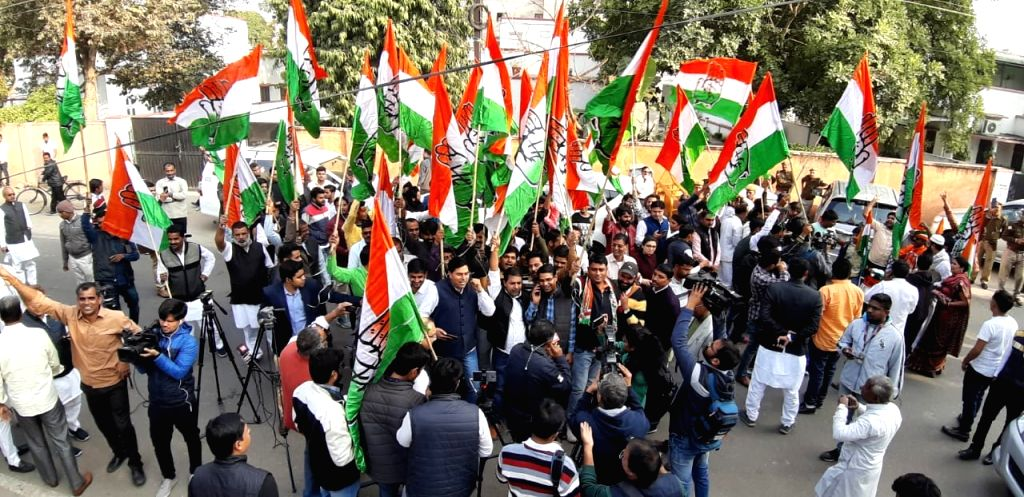 Party workers celebrate at Congress party office as Congress leads in the Rajasthan assembly elections in Jaipur on Dec 11, 2018.