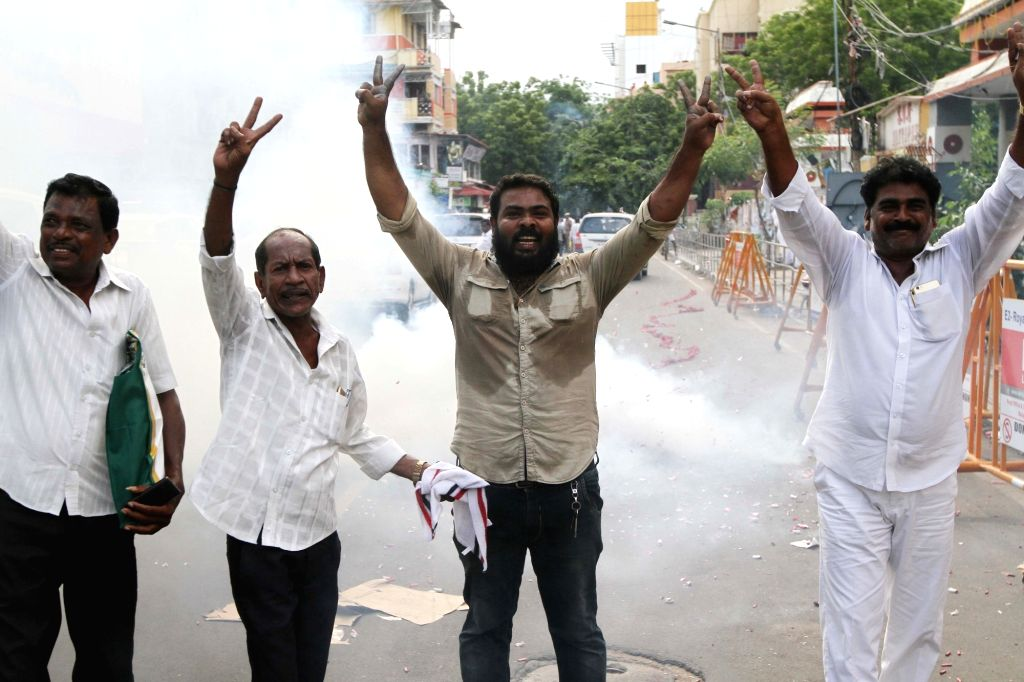 Party workers celebrate the merger of the two factions of the party in Chennai on Aug 21, 2017.