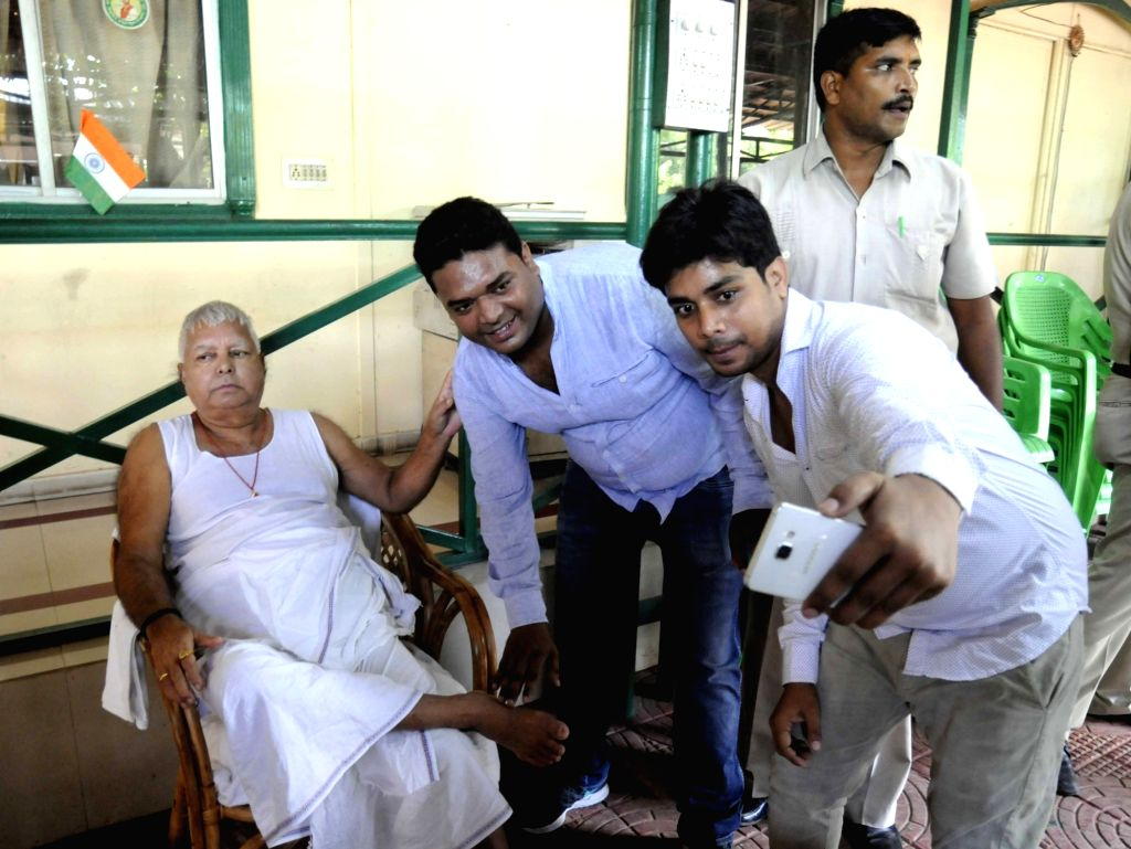 Party workers click a selfie - self portrait with RJD chief Lalu Prasad Yadav before leaving for the Desh Bachao, Bhajpa Bhagao rally at his residence in Patna on Aug 20, 2017. - Lalu Prasad Yadav