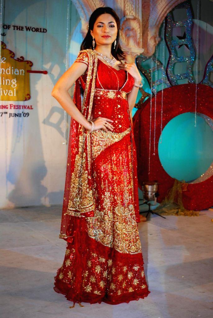 Parvathy Omanakuttan showcased designer Neeta Lulla's bridal collection at the Indian Wedding Carnival, Mayfair Rooms in Mumbai.