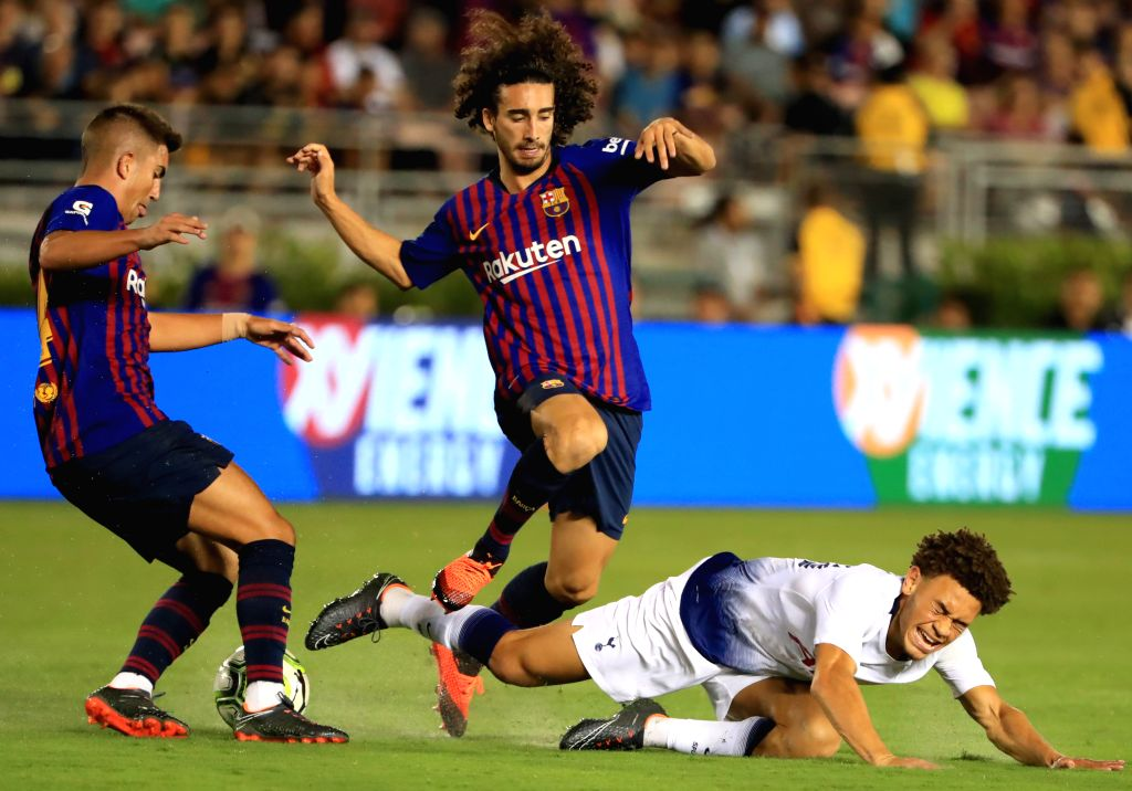 PASADENA, July 29, 2018 - Hotspur's Luke Amos (R) falls down during the International Champions Cup soccer match between Barcelona and Tottenham Hotspur in Pasadena, the United States, July 28, 2018. ...