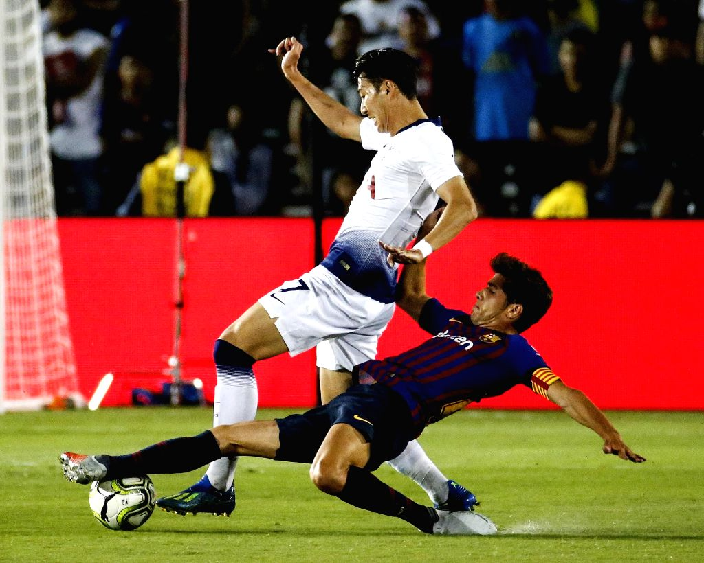 PASADENA, July 29, 2018 - Hotspur's Son Heung-Min (L) vies with Barcelona's Sergi Roberto during the International Champions Cup soccer match between Barcelona and Tottenham Hotspur in Pasadena, the ...
