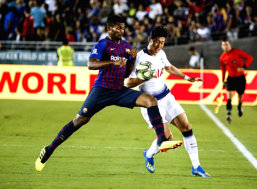PASADENA, July 29, 2018 - Hotspur's Son Heung-Min (R) vies with Barcelona's Nelson Semedo during the International Champions Cup soccer match between Barcelona and Tottenham Hotspur in Pasadena, the ...