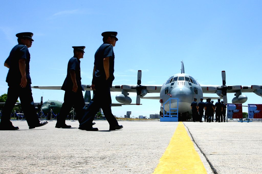 PASAY CITY, April 12, 2016 - Officers from the Philippine Air Force (PAF) take a look at a newly-acquired Lockheed C-130 military cargo transport plane during a turnover ceremony at Villamor Air Base ...
