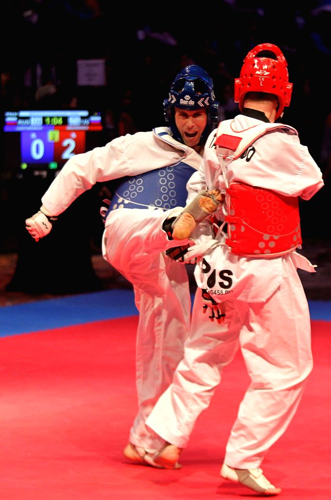 PASAY CITY, April 18, 2016 - Vitali Nazarenko (R) and Boris Chepirenkov of Russia compete during their semifinal match of the -75kg category in the 2nd Asian Para Taekwondo Championships in Pasay ...