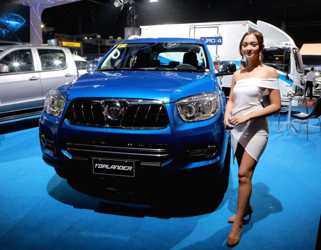 PASAY CITY, April 5, 2018 - A model poses beside a Foton Toplander car during the annual Manila International Auto Show at the World Trade Center in Pasay City, the Philippines, April 5, 2018.