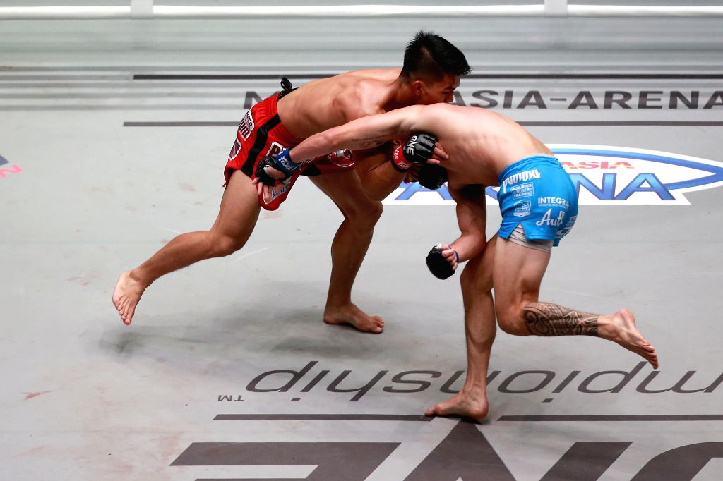 PASAY CITY, Aug. 3, 2019 - Danny Kingad (L) of the Philippnes competes against Reece Mclaren of Australia during their flyweight fight at the One Championship tournament in Pasay City, the ...