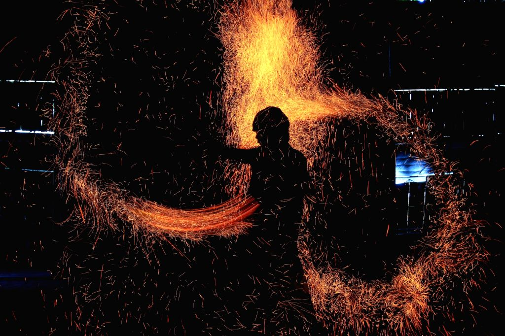 """A fire dancer performs during the """"Art of Fire"""" show in Pasay City, the Philippines, on Dec. 10, 2013. The """"Art of Fire"""" showcases ..."""