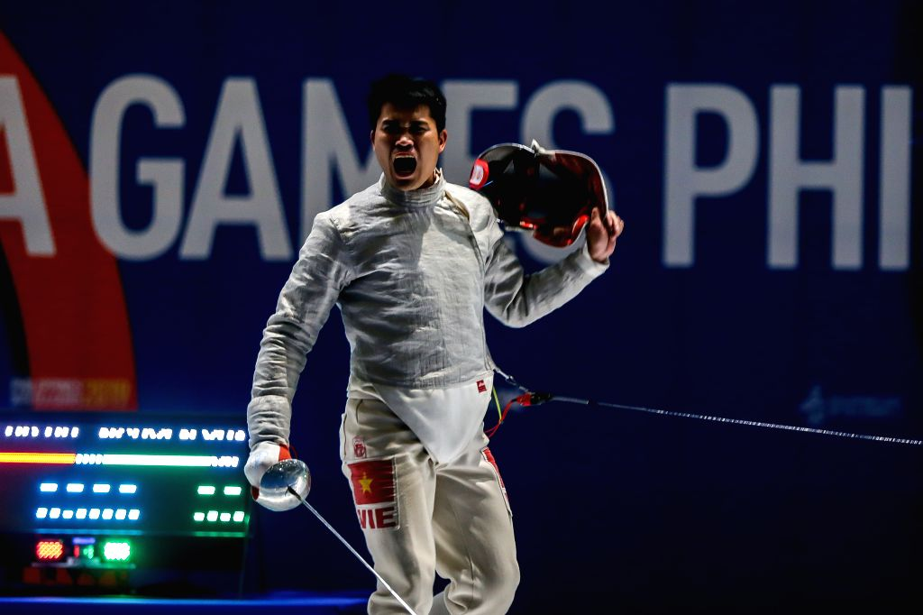 PASAY CITY, Dec. 6, 2019 - Nguyen Xuan Loi of Vietnam celebrates during the men's team sabre fencing final match between Vietnam and Thailand at the Southeast Asian Games 2019 in Pasay City, the ...