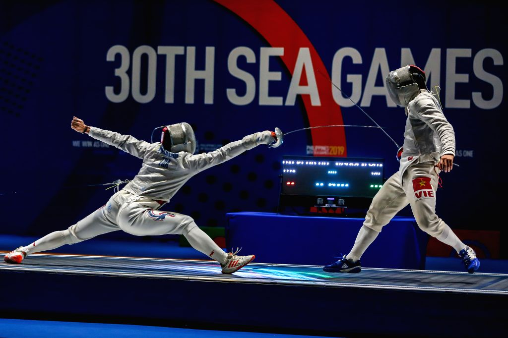 PASAY CITY, Dec. 6, 2019 - Nguyen Xuan Loi (R) of Vietnam competes against Ruangrit Haekerd of Thailand during the men's team sabre fencing final match between Vietnam and Thailand at the Southeast ...