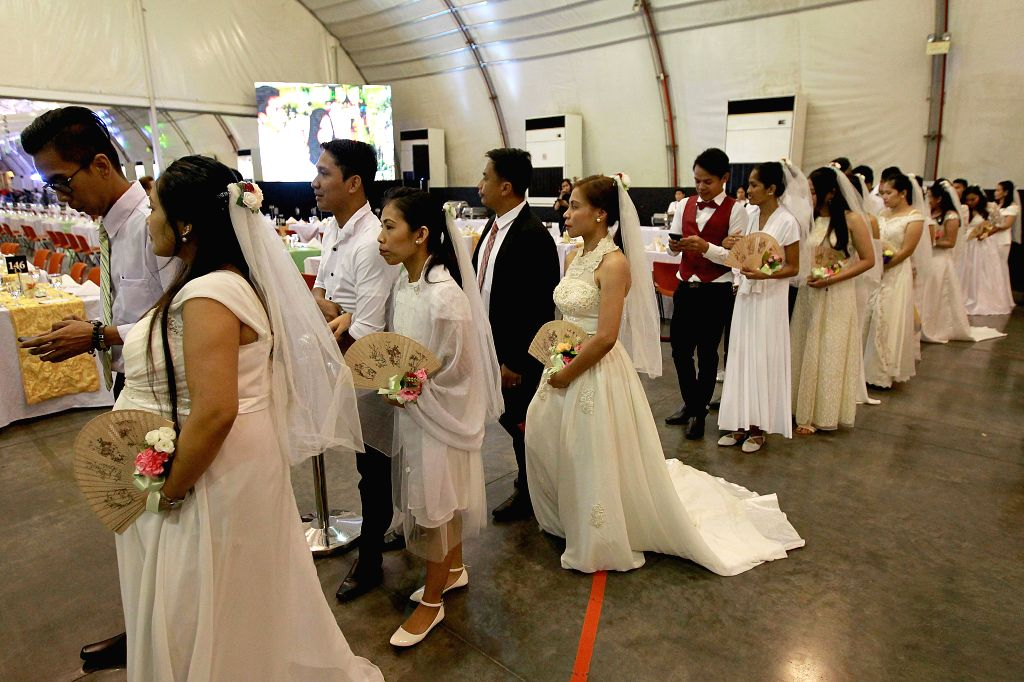 PASAY CITY, Feb. 14, 2019 - Couples wait for the mass wedding ceremony on Valentine's Day in Pasay City, the Philippines, Feb. 14, 2019. More than 300 couples took part in the event.