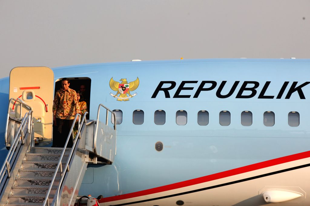 Indonesian President Joko Widodo disembarks from a palne during his arrival at the Villamor Airbase in Pasay City, the Philippines, Feb. 8, 2015. Widodo is on a .