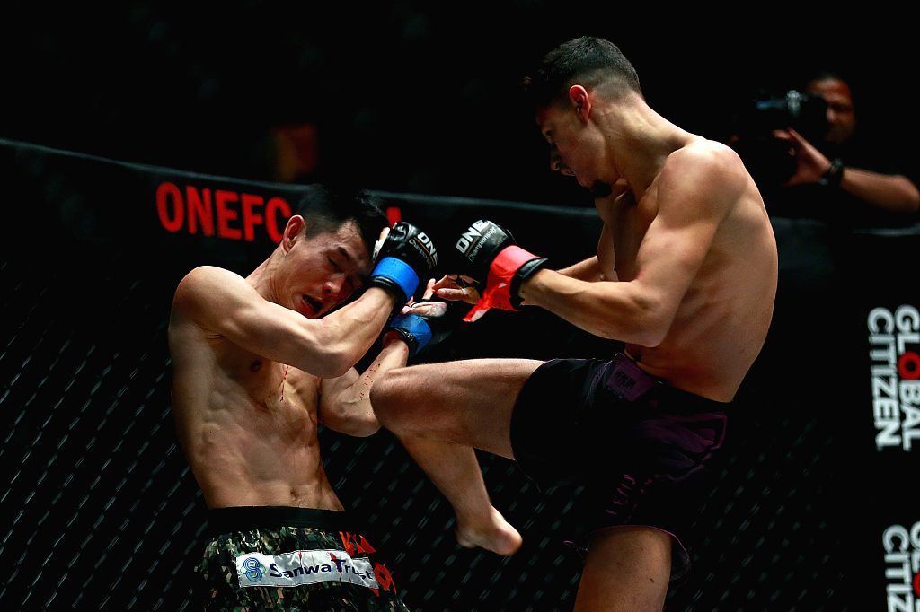 PASAY CITY, Jan. 26, 2019 - Elias Mahmoudi of Algeria (R) competes against Yukinori Ogasawara of Japan during their flyweight Muay Thai match in the One Championship in Pasay City, the Philippines, ...