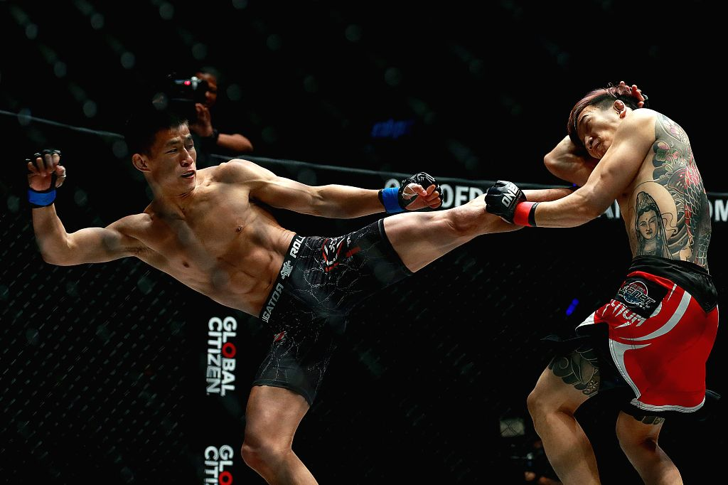 PASAY CITY, Jan. 26, 2019 - Tang Kai of China (L) competes against Sung Jong Lee of South Korea during their featherweight match in the One Championship in Pasay City, the Philippines, Jan. 25, 2019. ...