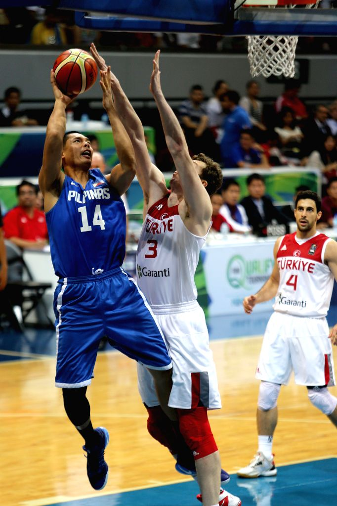 PASAY CITY, July 2, 2016 - Japeth Aguilar (L) of the Philippines goes up for a shoot during the FIBA Olympic Qualifying Tournament tuneup game against Turkey in Pasay City, the Philippines, July 1, ...