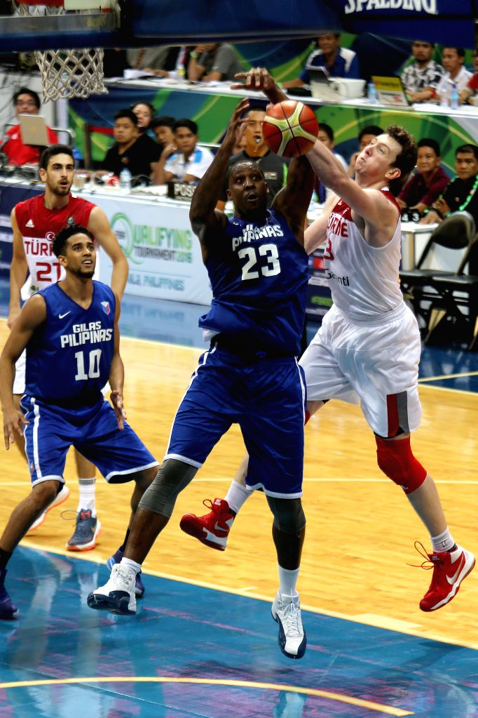 PASAY CITY, July 2, 2016 - Omer Asik (R) of Turkey defends Andray Blatche of the Philippines during the FIBA Olympic Qualifying Tournament tuneup game against Turkey in Pasay City, the Philippines, ...