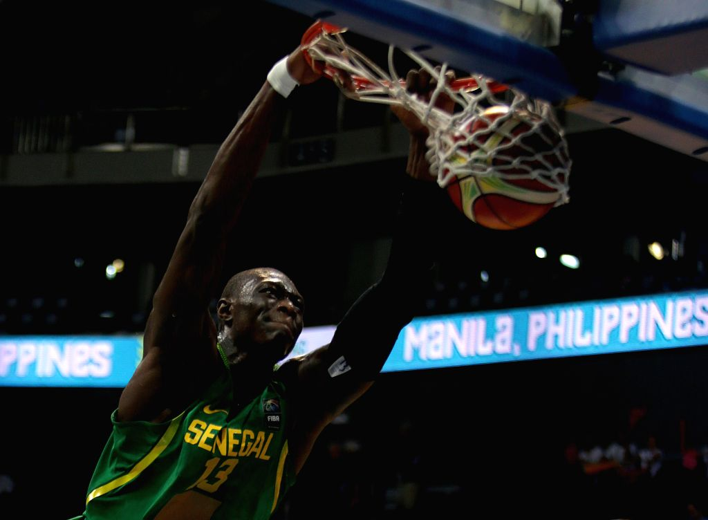 PASAY CITY, July 6, 2016 - Hamady Ndiaye of Senegal dunks the ball against Canada during their FIBA Olympic Qualifying Tournament in Pasay City, the Philippines, July 6, 2016. Canada won 58-55.