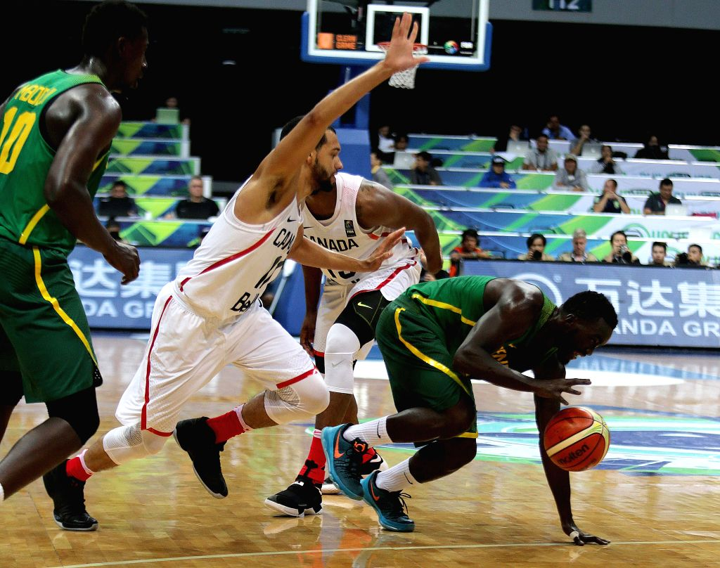 PASAY CITY, July 6, 2016 - Thierno Niang of Senegal (R) competes against Tyler Ennis of Canada (2nd L) during their FIBA Olympic Qualifying Tournament in Pasay City, the Philippines, July 6, 2016. ...