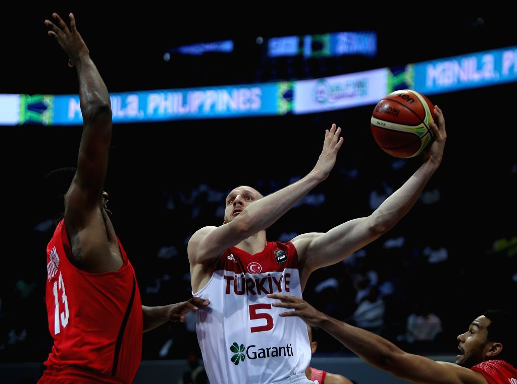 PASAY CITY, July 6, 2016 - Tristan Thompson (L) of Canada competes against Sinan Guler (C) of Turkey during their FIBA Olympic Qualifying Tournament in Pasay City, the Philippines, July 5, 2016. ...