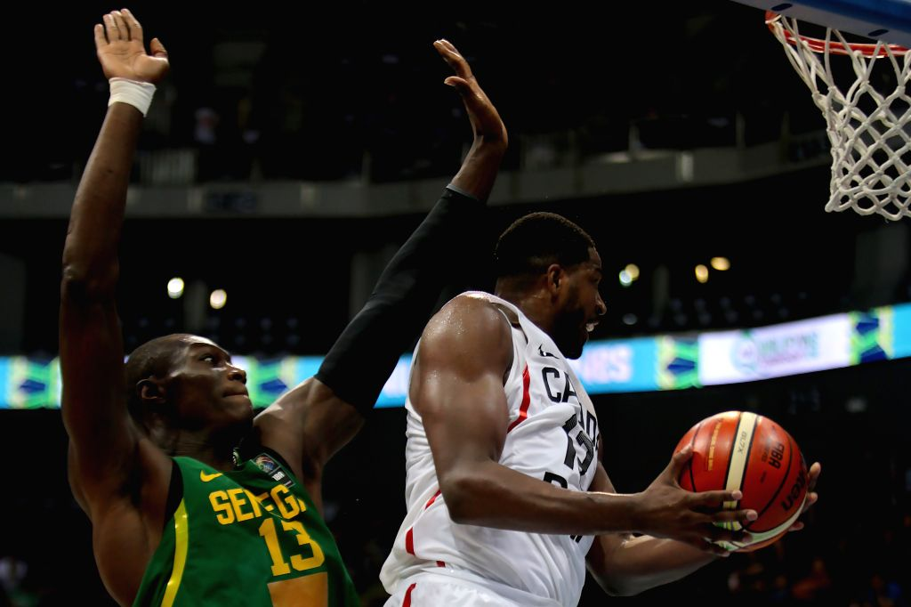PASAY CITY, July 6, 2016 - Tristan Thompson of Canada (R) competes against Hamady Ndiaye of Senegal during their FIBA Olympic Qualifying Tournament in Pasay City, the Philippines, July 6, 2016. ...