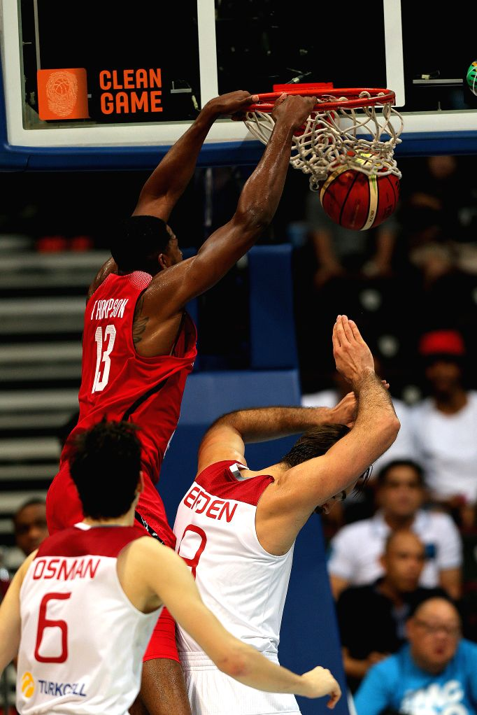 PASAY CITY, July 6, 2016 - Tristan Thompson (top) of Canada dunks against Semih Erden and Cedi Osman of Turkey during their FIBA Olympic Qualifying Tournament in Pasay City, the Philippines, July 5, ...