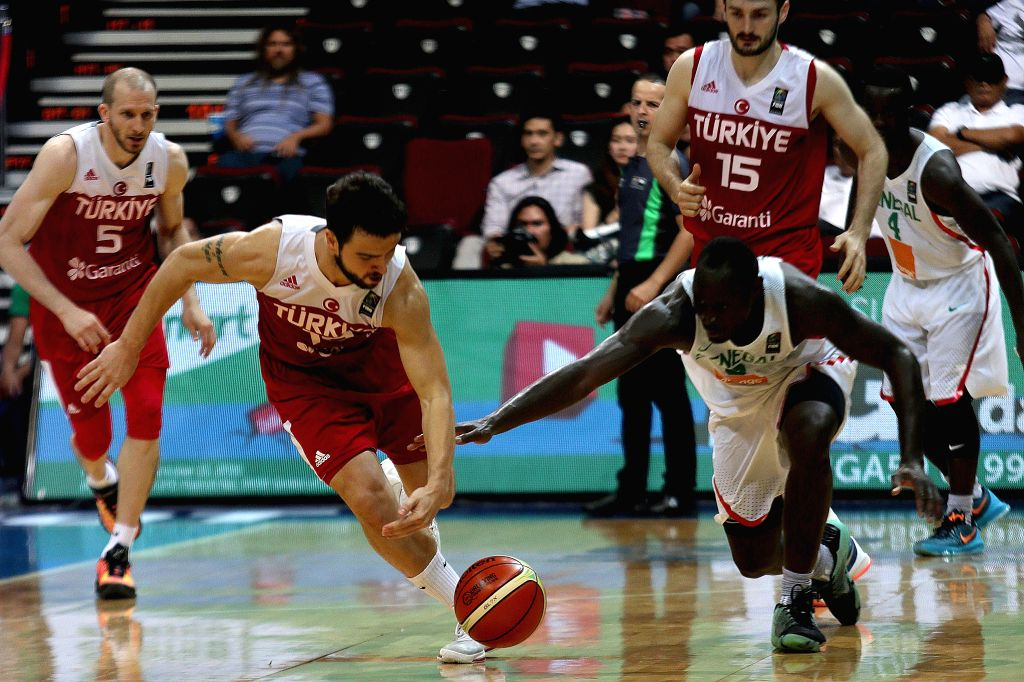 PASAY CITY, July 7, 2016 - Melih Mahmutoglu (L) of Turkey fights with Antoine Mendy of Senegal during their FIBA Olympic Qualifying Tournament in Pasay City, the Philippines, July 7, 2016. Turkey won ...
