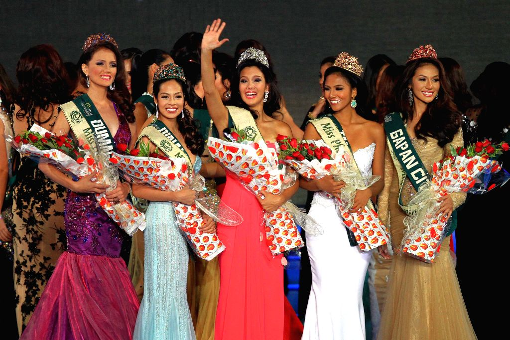 Newly-crowned 2014 Miss Philippines Earth Jamie Herrell (C) waves during the 2014 Miss Philippines Earth Coronation Night in Pasay City, the Philippines, on May ..