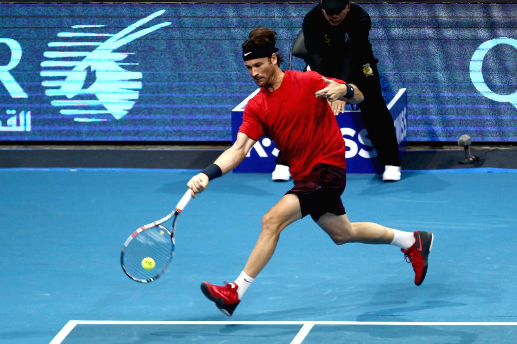 Pasay City (Philippines): Manila Mavericks player Carlos Moya of Spain returns the ball against United Arab Emirates (UAE) Royals player Goran Ivanisevic of Croatia during their match in the ...