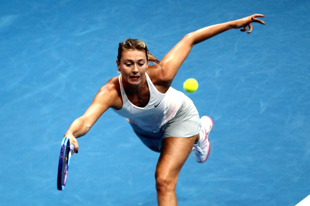 Pasay City (Philippines):Manila Mavericks player Maria Sharapova of Russia returns the ball against the Micromax Indian Aces player Ana Ivanovic of Serbia during their women's singles match in the ...