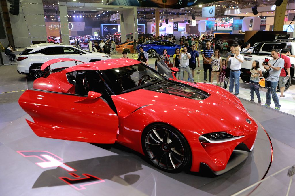 PASAY CITY, Sept. 18, 2016 - Visitors look at a car during the 6th Philippine International Motor Show at the World Trade Center in Pasay City, the Philippines, Sept. 18, 2016. The annual Philippine ...