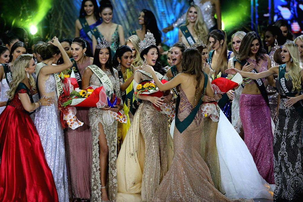 PASAY CITY (THE PHILIPPINES), Nov. 3, 2018 Phuong Khanh Nguyen (C) of Vietnam is greeted by other contestants during the coronation night of the Miss Earth 2018 in Pasay City, the ...