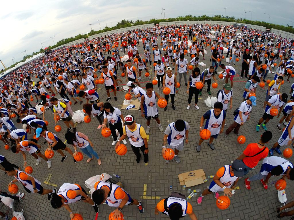 PASAY, July 21, 2019 - People dribble basketballs during an attempt to break the Guinness World Record for the most number of people dribbling basketball simultaneously, in Pasay City, the ...