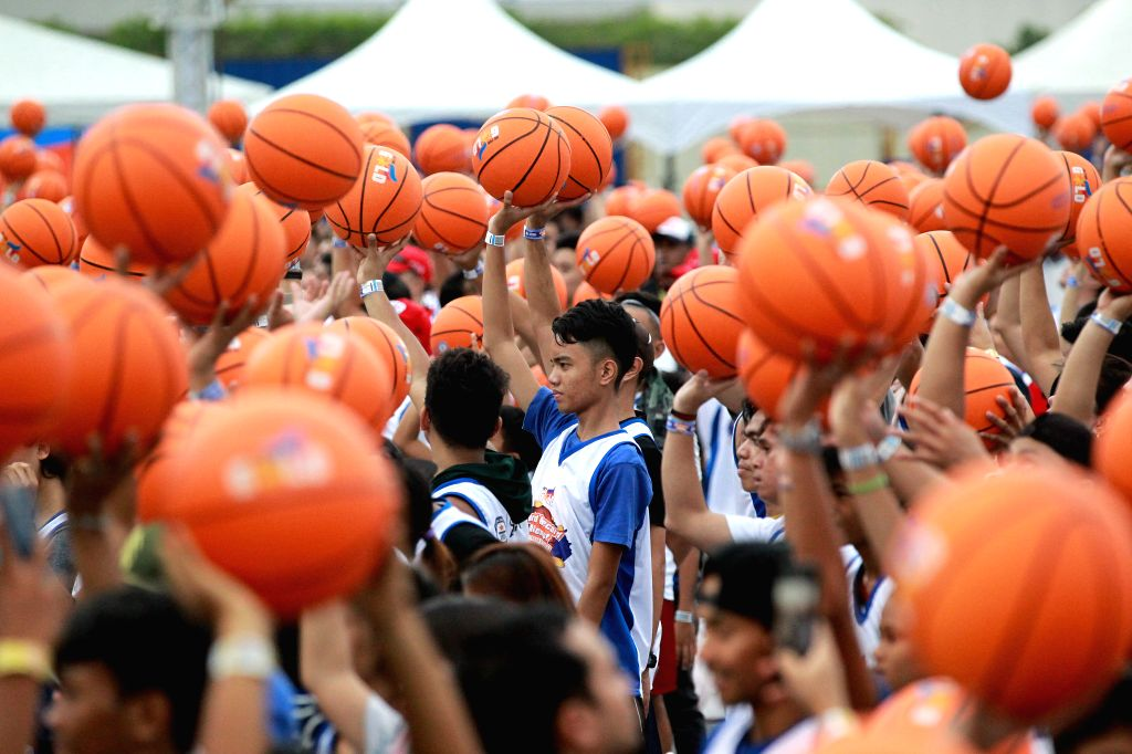 PASAY, July 21, 2019 - People hold their basketballs during an attempt to break the Guinness World Record for the most number of people dribbling basketball simultaneously, in Pasay City, the ...