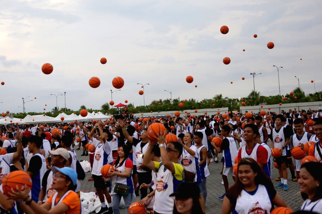 PASAY, July 21, 2019 - People throw basketballs in the air during an attempt to break the Guinness World Record for the most number of people dribbling basketball simultaneously, in Pasay City, the ...