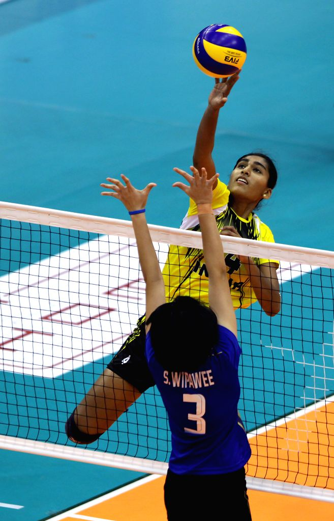 India's Ghosh Anusri (Top) spikes the ball during the match against Thailand at the 1st Asian U-23 Women's Volleyball Championship in Pasig City, the Philippines, ...