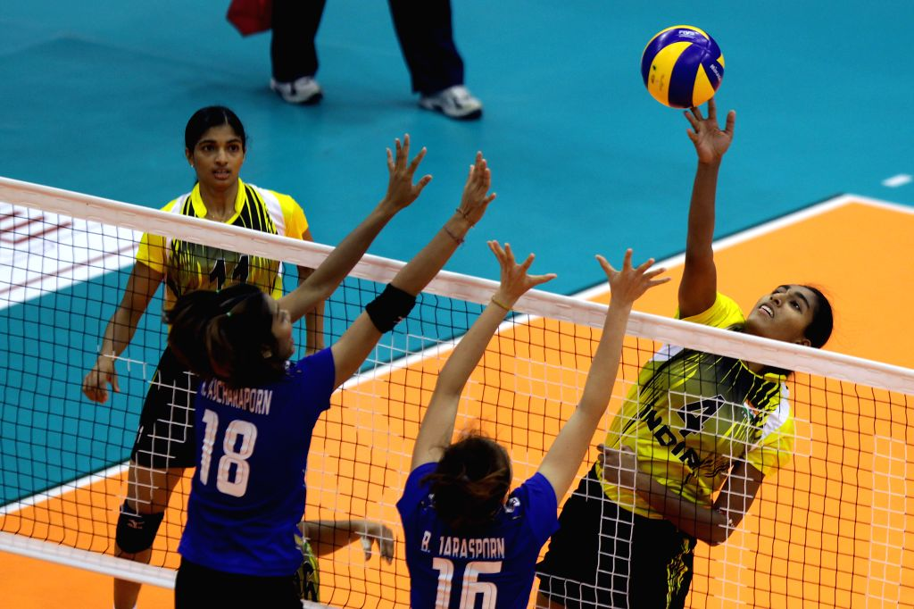 India's Ghosh Anusri (R) spikes the ball during the match against Thailand at the 1st Asian U-23 Women's Volleyball Championship in Pasig City, the Philippines, on ...