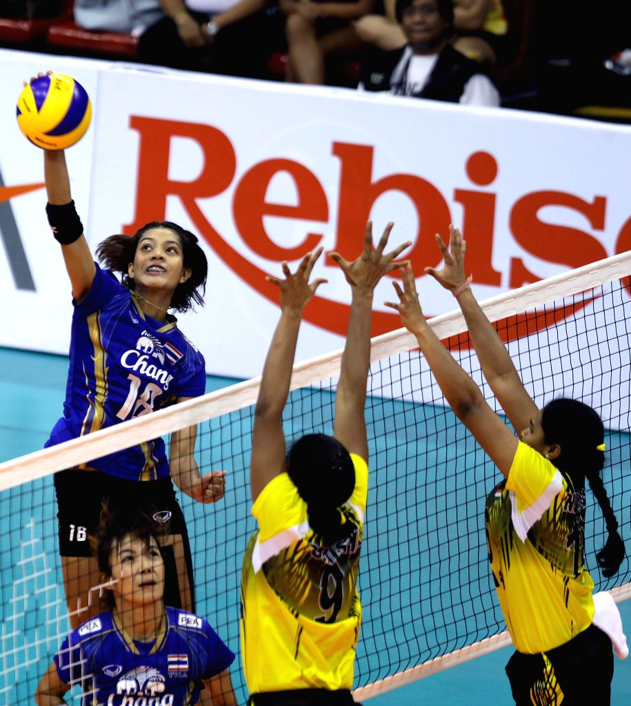 Thailand's Ajcharaporn Kongyot (1st L) spikes the ball during the match against India at the 1st Asian U-23 Women's Volleyball Championship in Pasig City, the ...