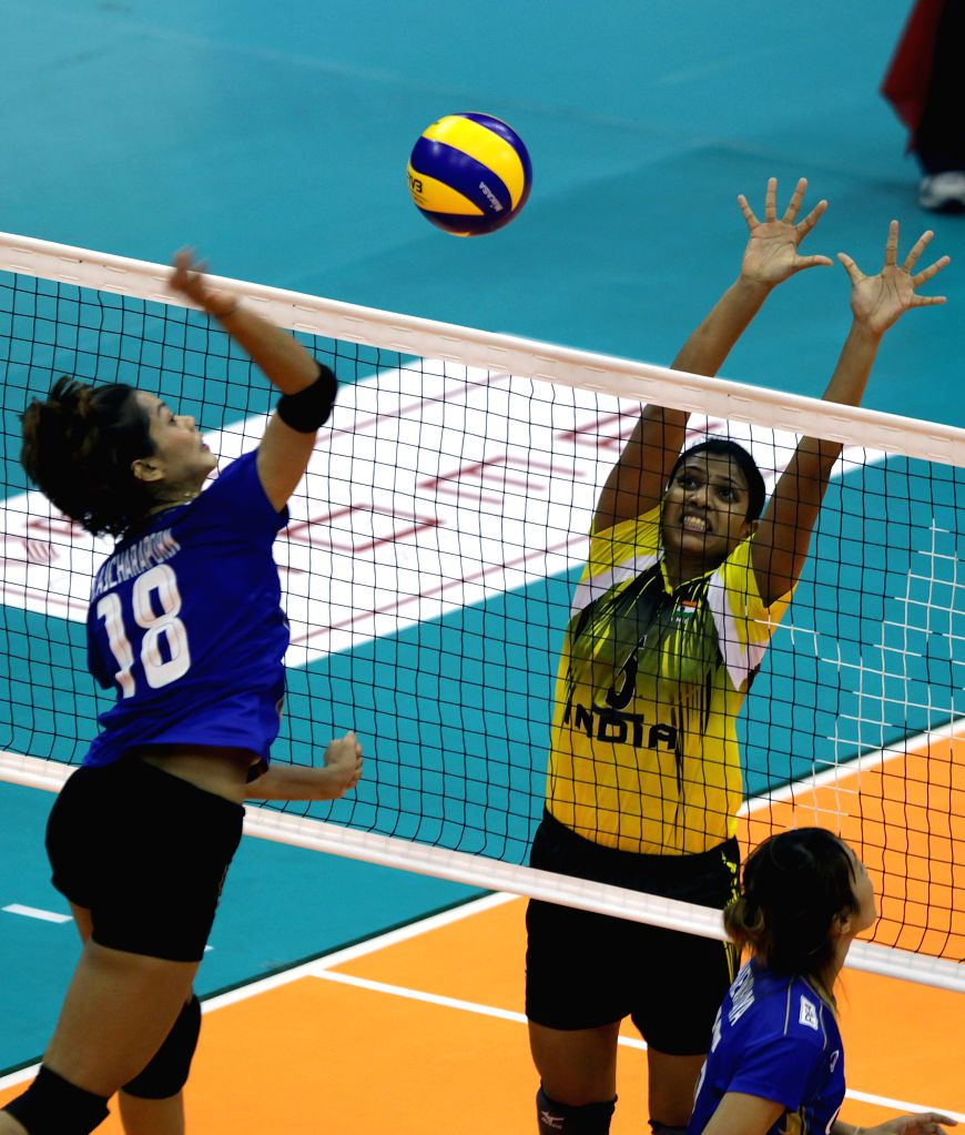 Thailand's Ajcharaporn Kongyot (L) spikes the ball during the match against India at the 1st Asian U-23 Women's Volleyball Championship in Pasig City, the ...
