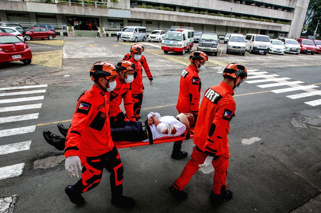 PASIG CITY, Nov. 14, 2019 - Rescuers attend to a mock earthquake victim as they participate in the national simultaneous earthquake drill in Pasig City, the Philippines, Nov. 14, 2019. The national ...