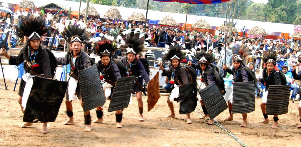 Adi warriors perform their traditional dance during the inaugural function of the 1st Arunachal Spring carnival in Pasighat in East Siang district of Arunachal Pradesh on March 17, 2015.