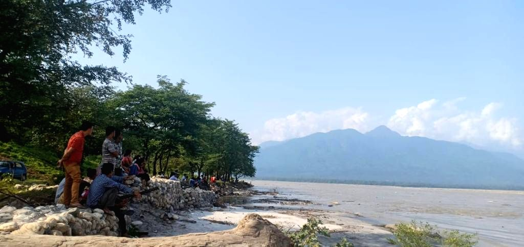 : Pasighat: Central Water Commission (CWC) officials monitor the water levels in the Siang river following fears about sudden bursting of an artificial lake formed by a landslide on the Tibetan side ...